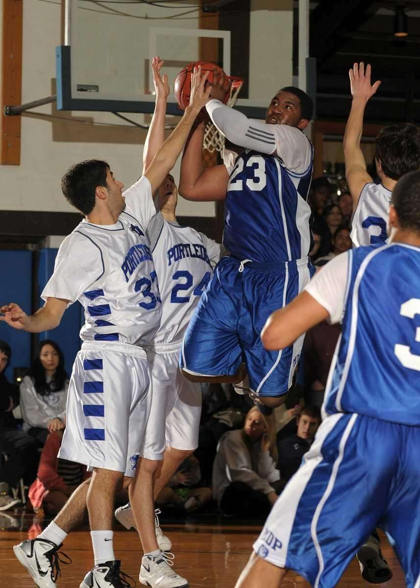 Martin DePorres' Tariq Miller (23) goes over the