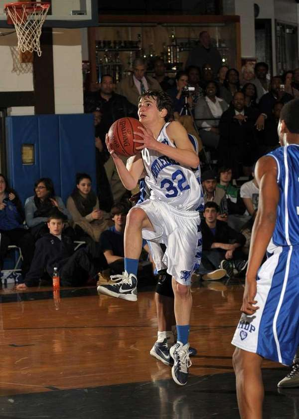 Portledge's David Lustberg (32) goes up for a