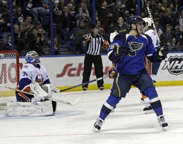 Blues' David Perron celebrates a goal by teammate