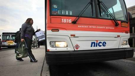 A rider boards a NICE buses at the