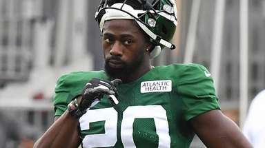 The Jets' Marcus Maye looks on during training
