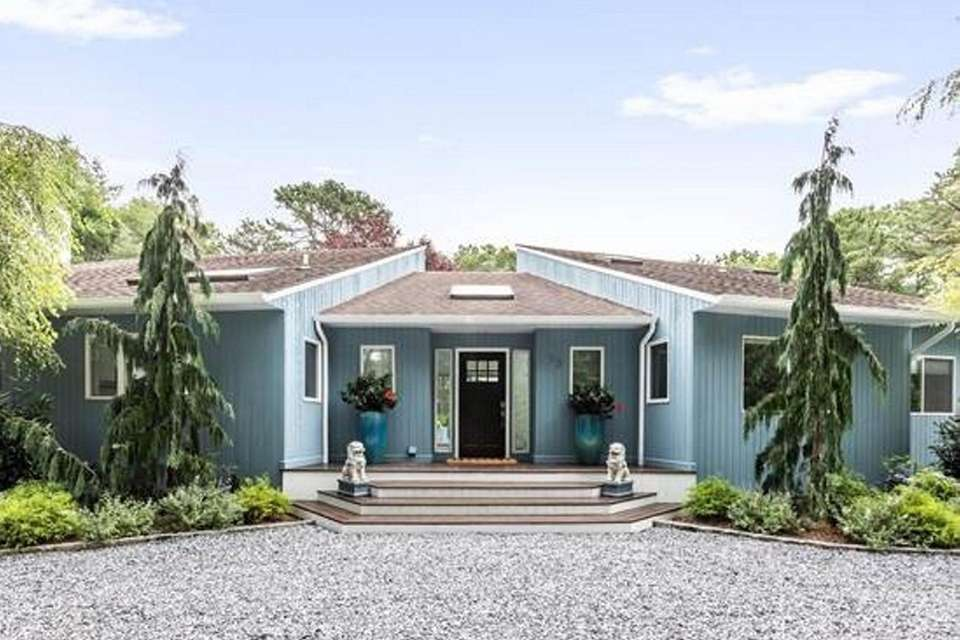 This East Quogue Contemporary has four bedrooms and