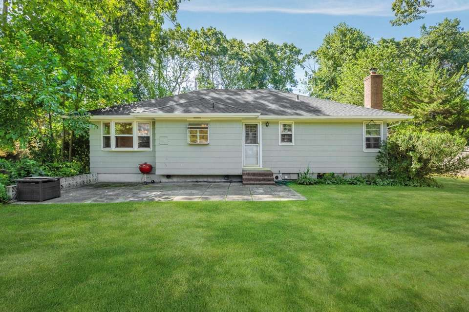 This Melville ranch has three bedrooms and 1-1/2