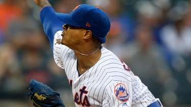 Mets pitcher Marcus Stroman delivers during the first