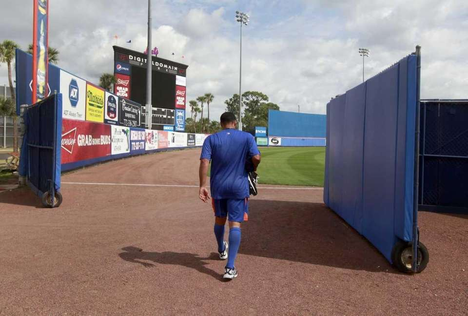 New York Mets pitcher Johan Santana walks into