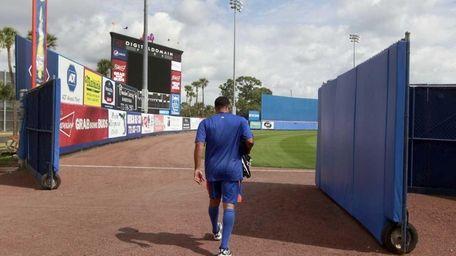 New York Mets pitcher Johan Santana walks into