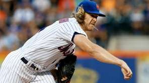 Noah Syndergaard #34 of the Mets pitches during