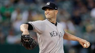 Yankees' J.A. Happ pitches against the A's on