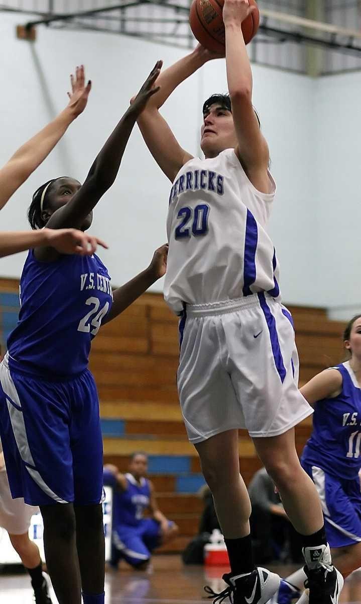 Herricks' Kim Givelechian attacks the basket against Valley