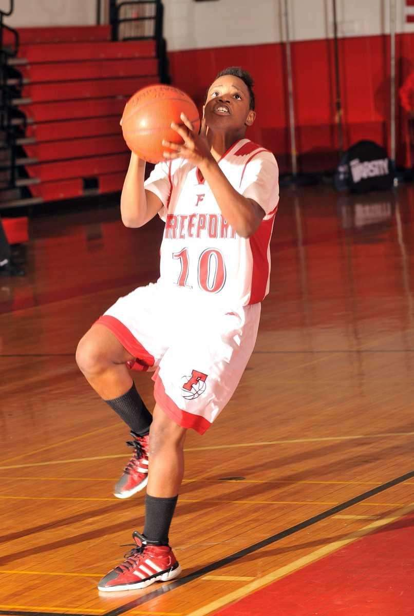 Freeport's Sydney Harris goes up for a shot.
