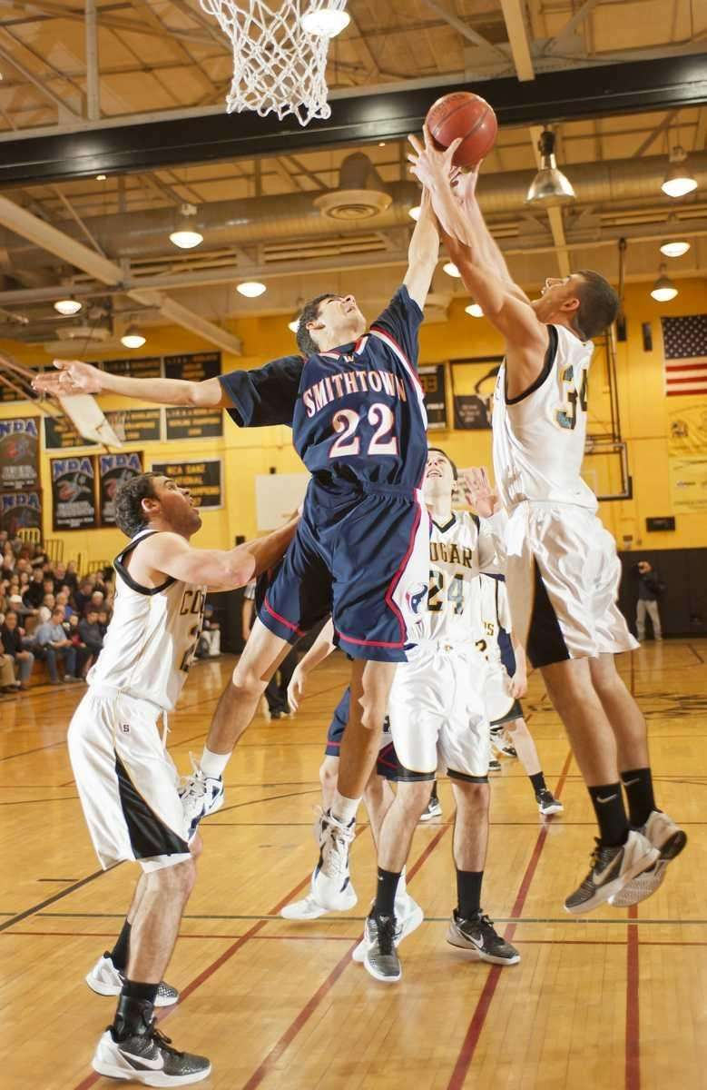 Commack's John Stathis (34, right) goes up for
