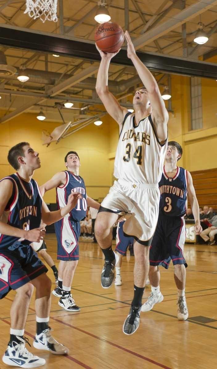 Commack's John Stathis splits Smithtown West's defense on
