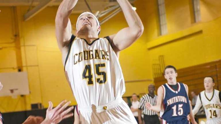 Commack's Michael Karaolis splits Smithtown West's defense on