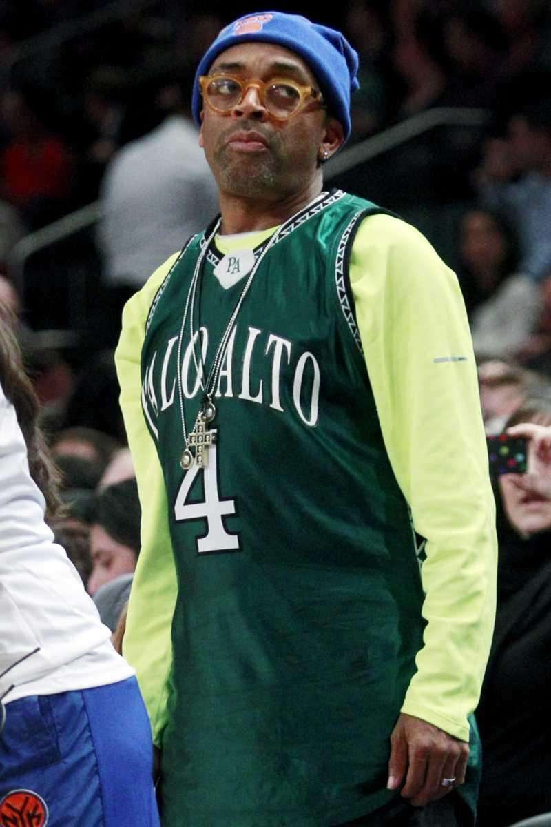 Filmmaker Spike Lee watches from the sideline while