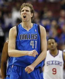 Dallas Mavericks power forward Dirk Nowitzki reacts after
