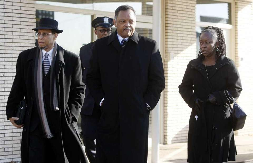 The Rev. Jesse Jackson, center, leaves Whigham Funeral
