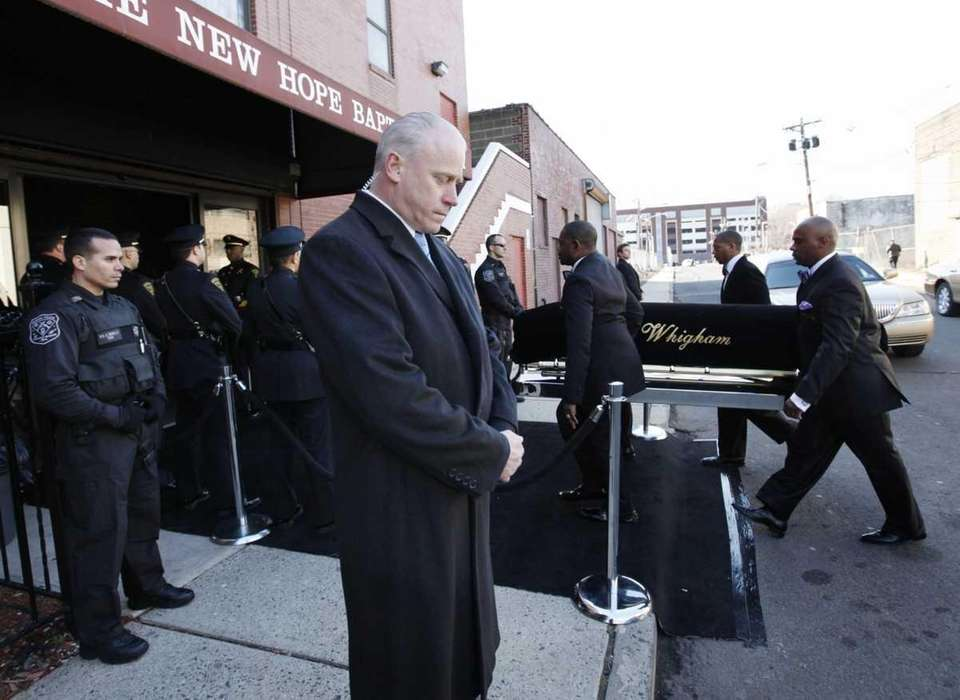 A coffin holding the remains of singer Whitney