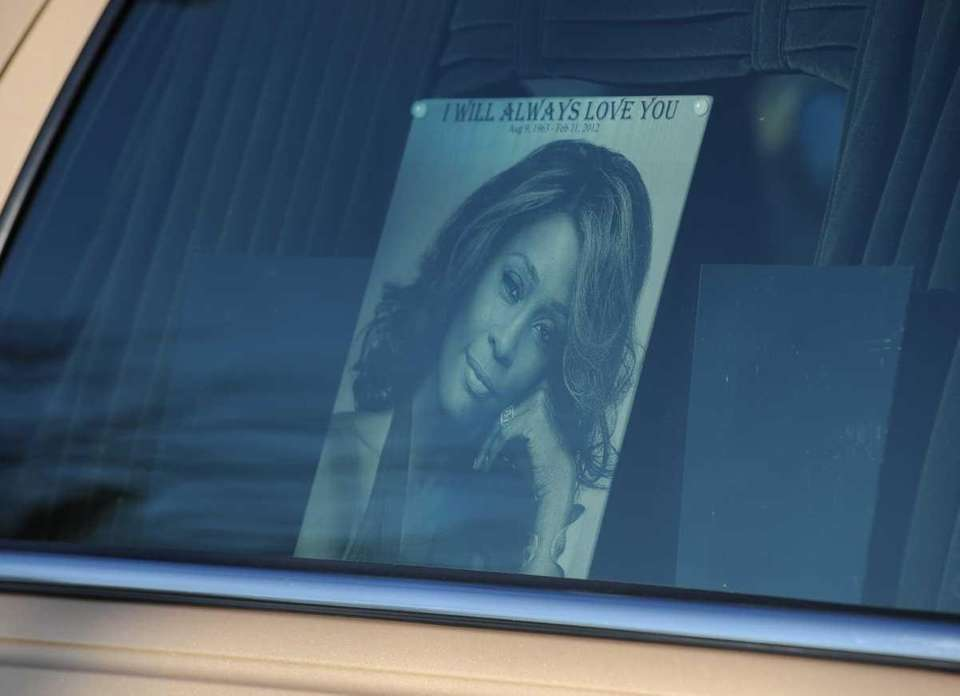The hearse carrying the body of singer Whitney
