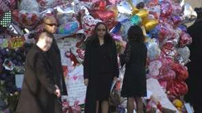Mourners arrive at the funeral service for singer