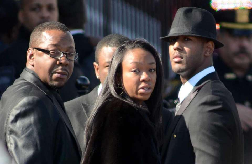 Bobby Brown, left, ex-husband of Whitney Houston, arrives