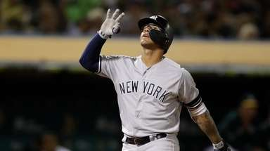 New York Yankees' Gleyber Torres celebrates after hitting