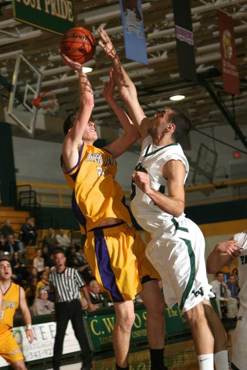 Locust Valley HS's Alex Rowa blocks a shot