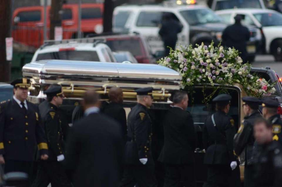Whitney Houston's coffin is carried to the hearse