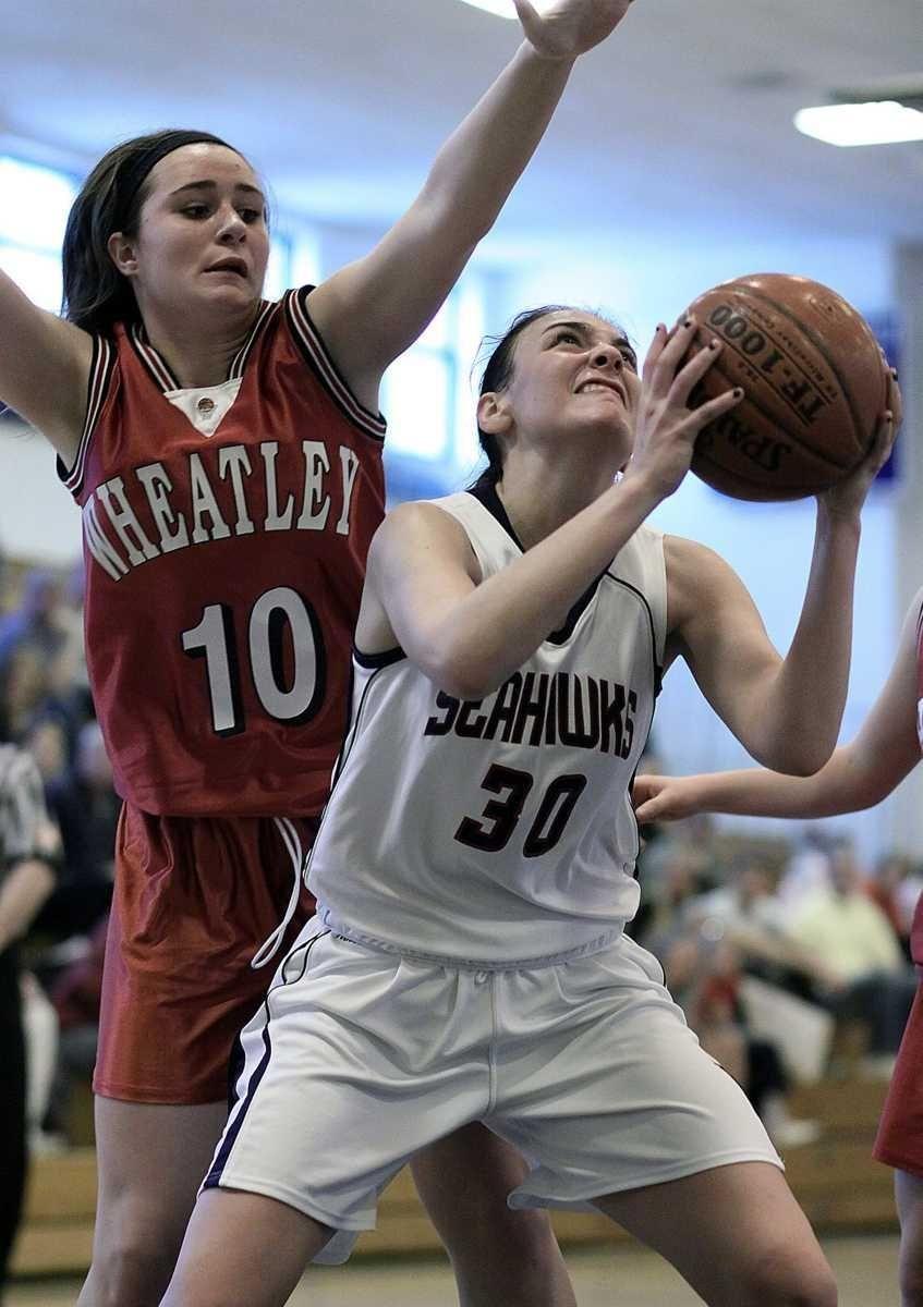 Cold Spring Harbor's Kelly Gubitosi under the basket