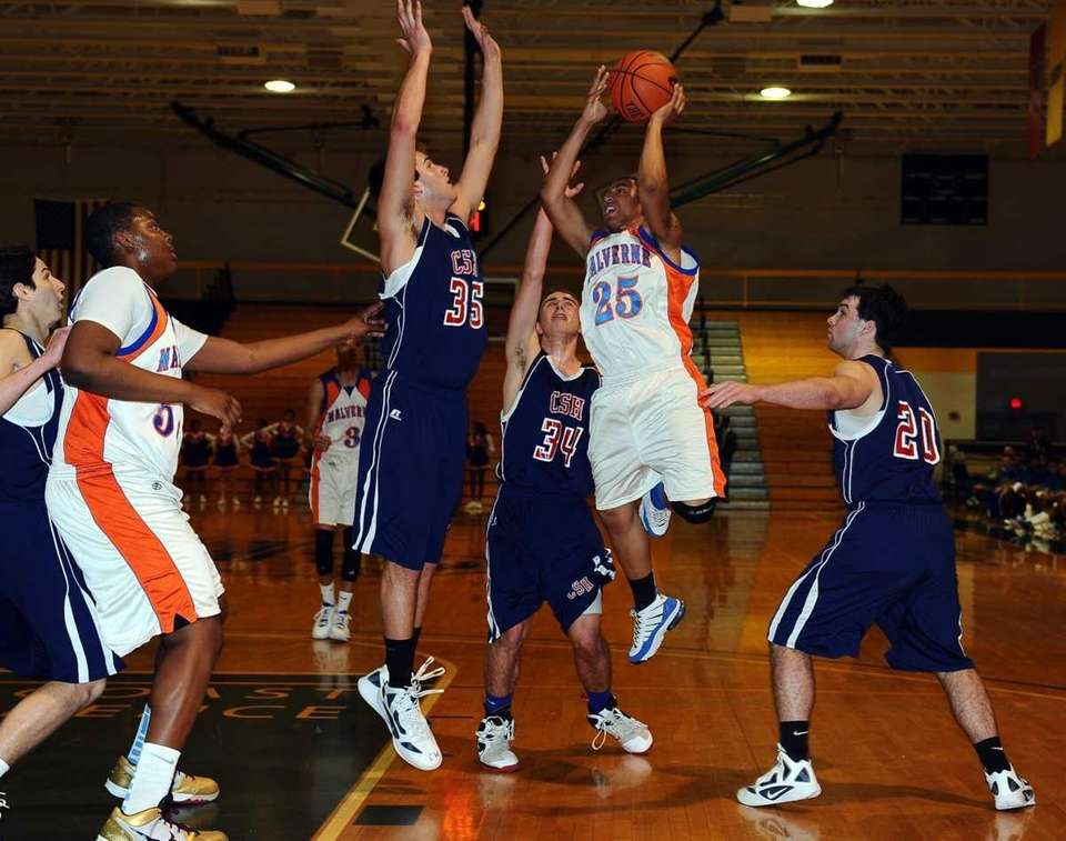 Malverne's Cyrus Clarke drives on Cold Spring Harbor's