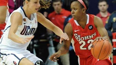 Connecticut's Caroline Doty, left, guards St. John's Eugeneia
