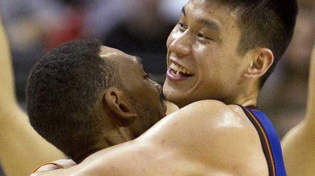 New York Knicks guard Jeremy Lin, right, celebrates