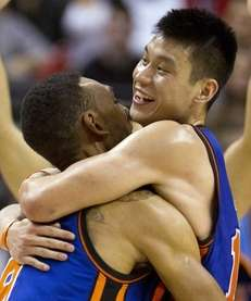 New York Knicks guard Jeremy Lin, right, celebrates