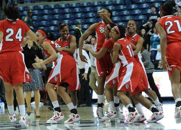St. John's players celebrate at the end of