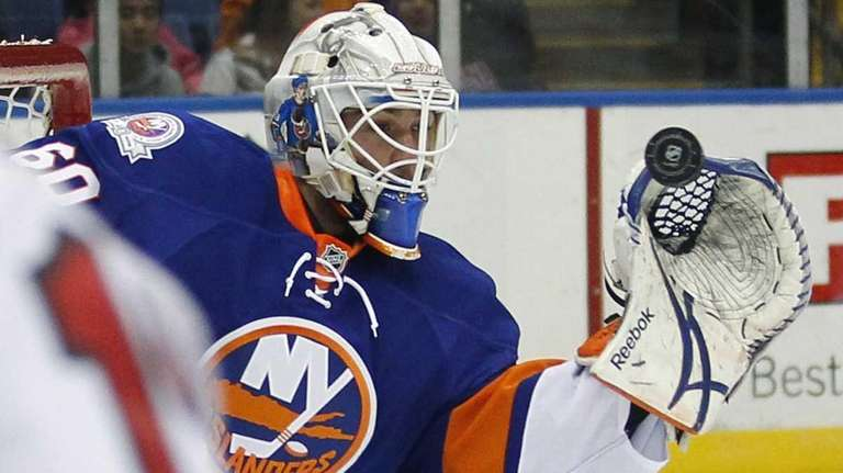 Islanders goalie Kevin Poulin stops a shot against