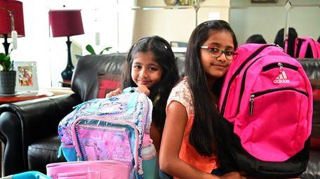 The Goel siblings, Vanya, 5, and Ojasvi, 9,