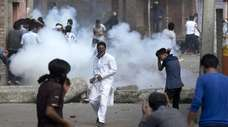 Kashmiri Muslims take part in a protest in