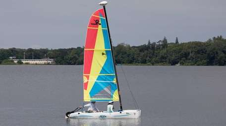 A couple sails a catamaran on Lake Ronkonkoma.