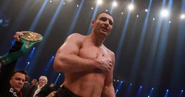 Vitali Klitschko of Ukraine celebrates after winning his