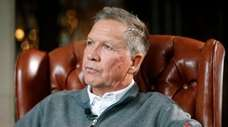 Then-Ohio Gov. John Kasich sits for an interview
