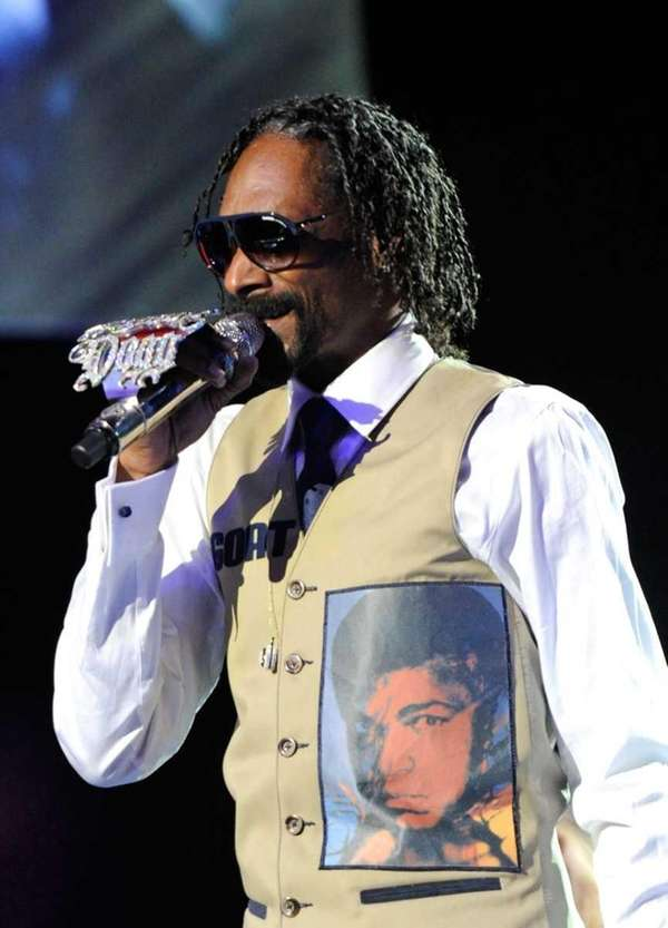 Rapper Snoop Dogg performs during a benefit celebration