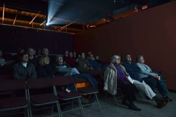 "Patrons enjoy a screening of ""Angels Crest"" at"