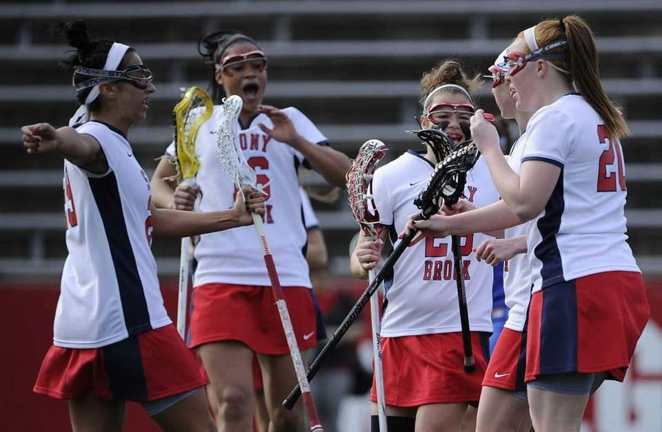 Stony Brook players celebrate a goal against Central