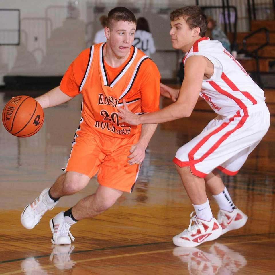 East Rockaway senior Mikey Lores, left, looks to