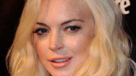 Actress Lindsay Lohan arrives at The Weinstein Company's