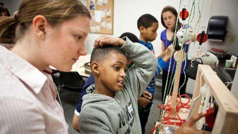 Lauren Mrachko works with Lassaun Corley, 9, in