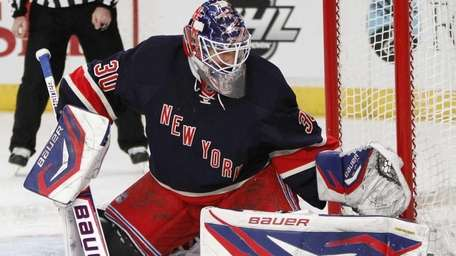 New York Rangers goalie Henrik Lundqvist blocks a