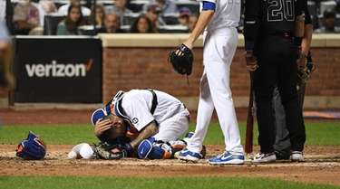 New York Mets catcher Tomas Nido reacts after