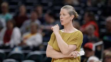 New York Liberty head coach Katie Smith watches