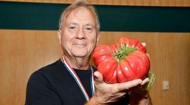 William Bouziotis, of Northport, shows off his 3-pound,
