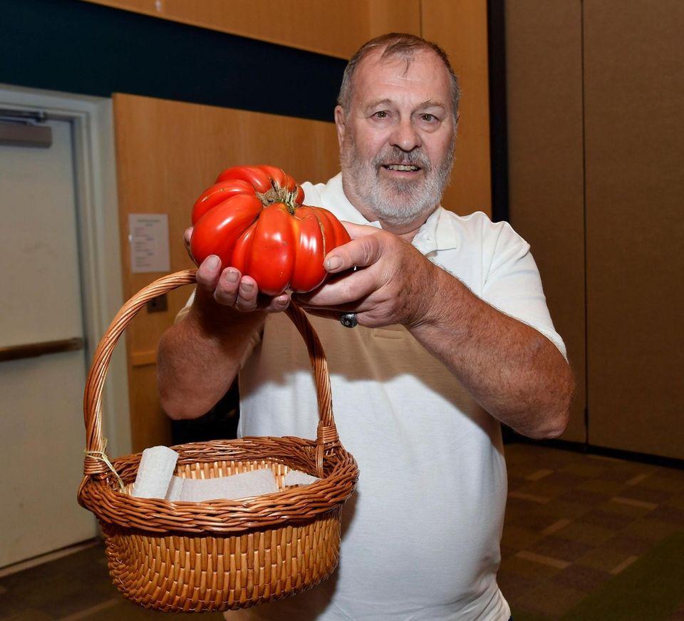 Gary Schaffer of Lindenhurst shows off his tomato